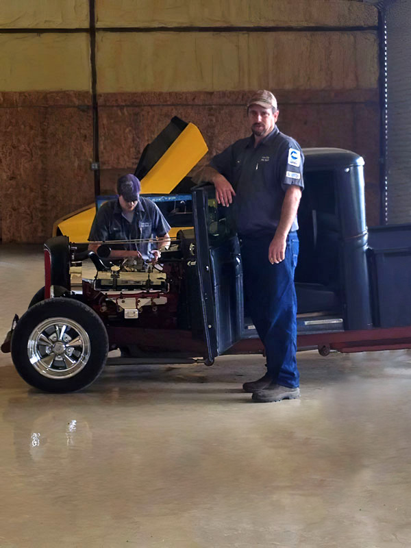 Evan McDaniel owner and eldest son Devan McDaniel owner Labor Only Auto Repair in Hutto Texas in their auto repair shop working on antique classic truck